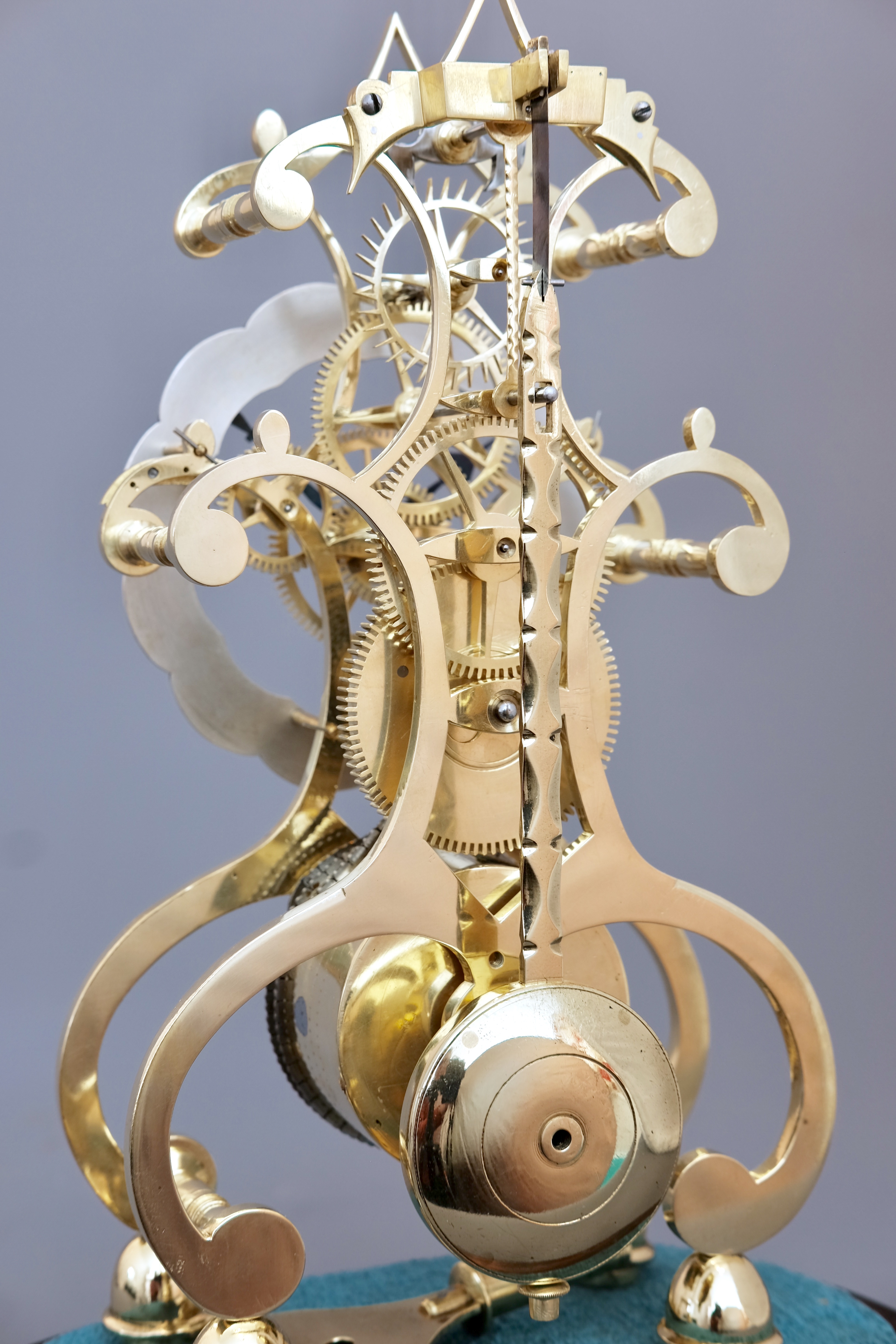 Detail of Victorian brass timepiece skeleton clock