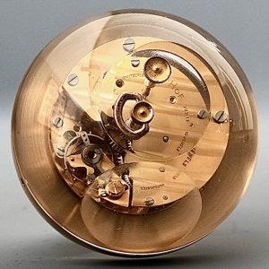 back of mid century globe desk clock